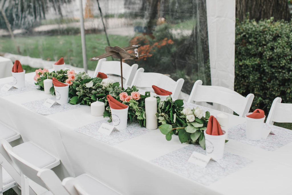 Image of Head Table with White Padded Chairs