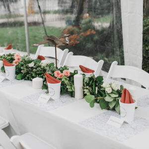 Image of Wedding Rental Head Table with White Padded Chairs