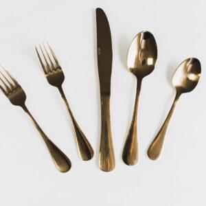 Image of gold flatware rental